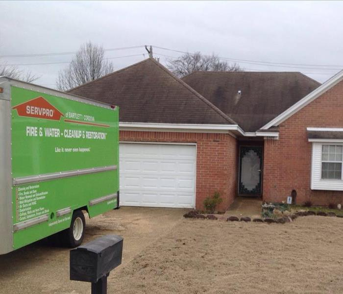 SERVPRO truck in front of house