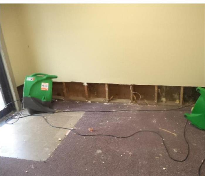 SERVPRO equipment with drywall cut